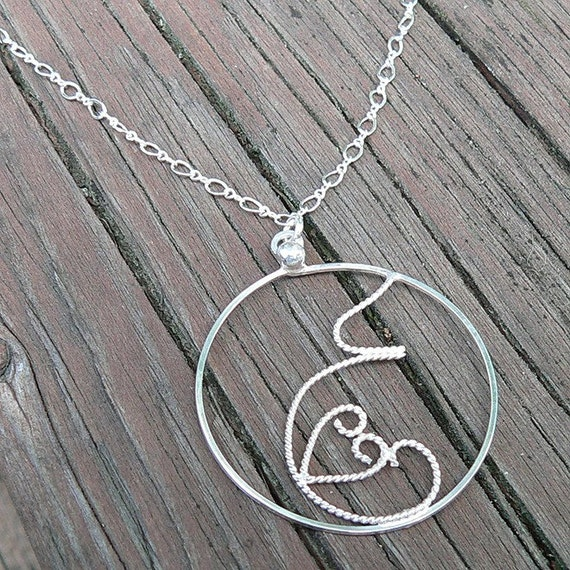 Fluttering Love...a sterling silver handmade filigree pregnancy pendant