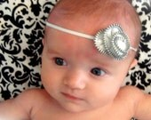 Petite white ZIPPER flower, perfect for your baby