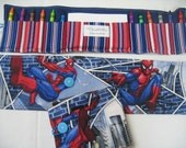 50% OFF Spiderman Crayon Tote in a colorful print complete with 12 crayons and a paper pad