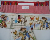 Cowgirl Crayon Tote in a colorful print complete with 12 crayons and a paper pad