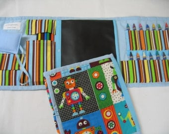 Robot Art Tote in a colorful robot print complete with crayons, colored pencils, chalk, chalkboard, eraser, pencil, and paper pad