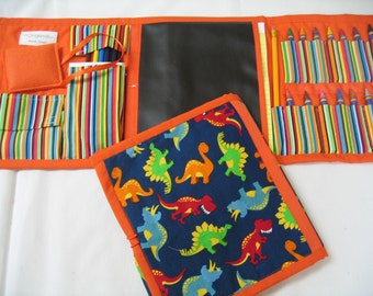 Dinosaur Art Tote in a colorful print complete with chalk, eraser, chalkboard, colored pencils, pencil, paper pad, and crayons