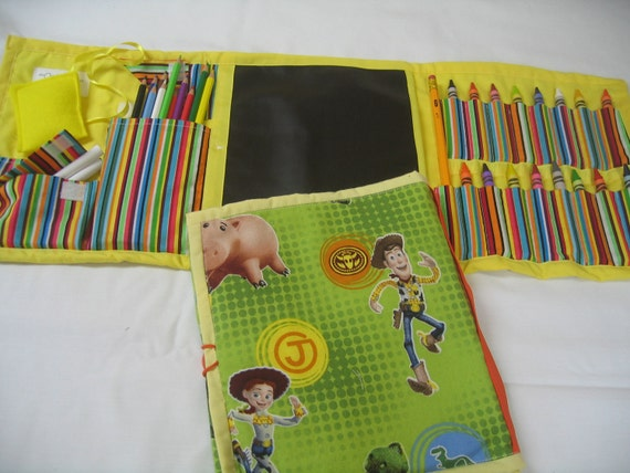 Toy Story Art Travel Tote in a Colorful Print complete with chalk board, chalk, eraser, crayons, paper, and colored pencils