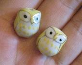 2 yellow owls- porcelain bead