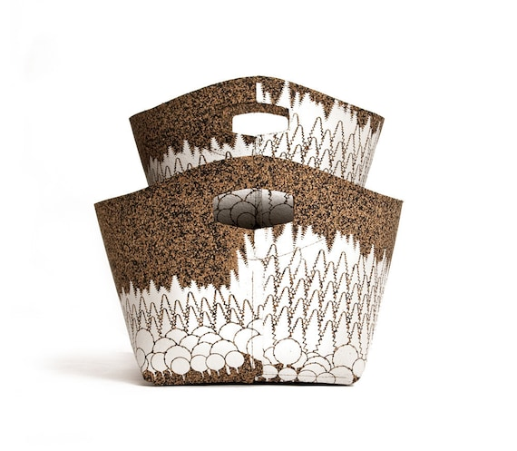 two baskets with white forest print, cork