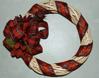 Small willow branch wreath with plaid ribbon bow and matching flowers