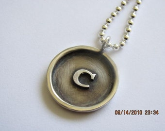 Sterling silver framed disc necklace with Raised silver initial