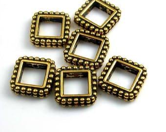 6 medium gold frames -  tierracast beads