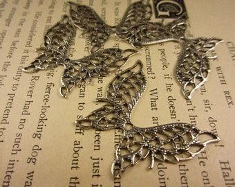 4 Silver Oxide Stamped Filigree Butterflies