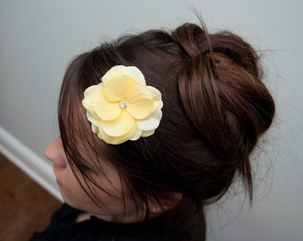 Soft Yellow Flower Hairclip with a Diamond in the middle on an Alligator Clip