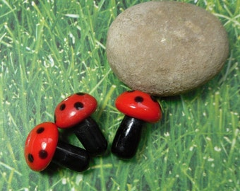 2 red and black polka dot mushroom lampwork glass beads - loose beads - jewelry and craft supply