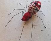 Soft sculpture Spider with Vintage button spots.