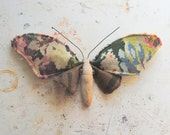 Moth made from vintage hand embroidered tapestry.