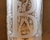 Hand etched wine bottle. Does not include the stopper and coaster shown...will be replaced with a resin grape cluster stopper.