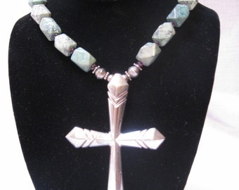 1970 sandcast cross with faceted turquoise beads
