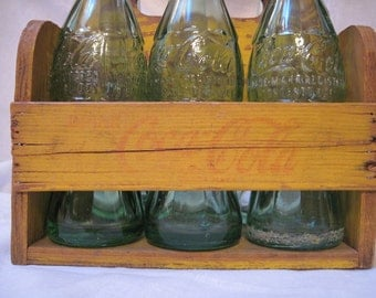 1940's wooden Coca Cola holder and 6 vintage bottles