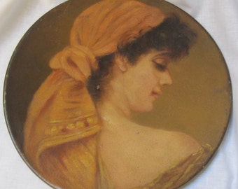 Vintage hand painted woman on metal plate