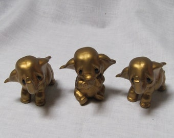 Vintage Norcrest gold elephants with sad faces