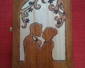 Wooden box with silhouettes of a woman and a man