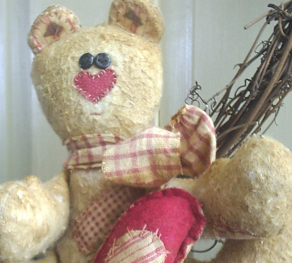 Raggedy Country Patched-Up Bear sitter with Heart Ornie