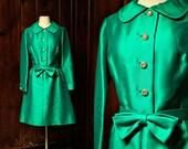SALE 1960s dress : emerald green . a line skirt . bow . rhinestones . size medium holiday party dress