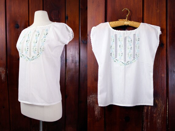 white cotton top / boho blouse / 1960s vintage hippie peasant shirt / blue embroidered flowers size S