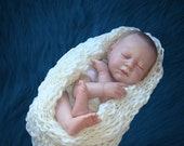 Soft stretchy milk-white  cocoon from textured  yarn. Perfect for photo prop.
