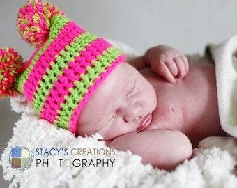 Bright Tutti frutti square hat with 2 pompoms. Sizes 0 - 12 month.