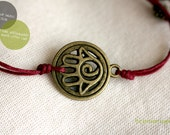The luckiest-  Bracelet with hamsa charm and waxed cotton cord in dark red