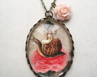 A Fairy Holding a Leaf, Sitting on a Snail Above a Rose Necklace