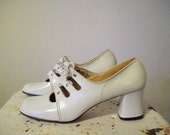 RESERVED Vintage 1960s Mary Janes white lace up 2 1/2 inch heel excellent condition size 9
