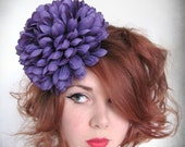 Purple pom pom flower fascinator