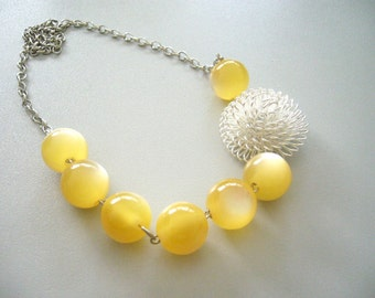 yellow necklace. chunky style. retro