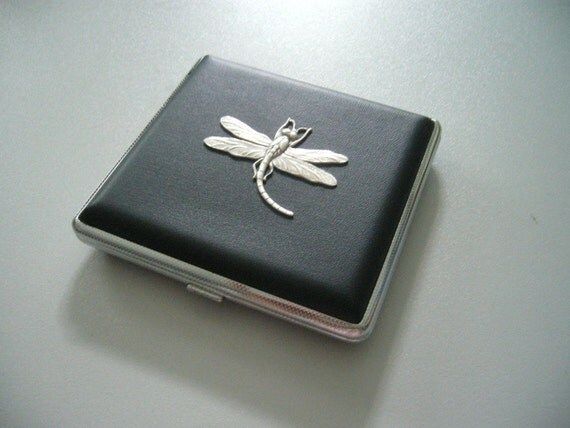 A black leather and dragonfly cigarette hard case