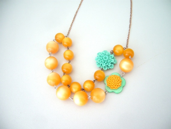 Orange flower necklace with teal cabochon