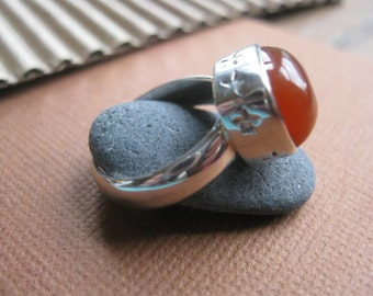STERLING SILVER and carnelian ring ...Little stars on the side.