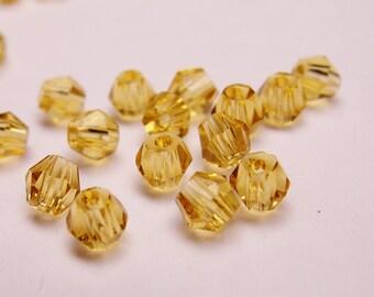 Crystal 3mm Bicone 100 pcs AA quality --yellow topaz