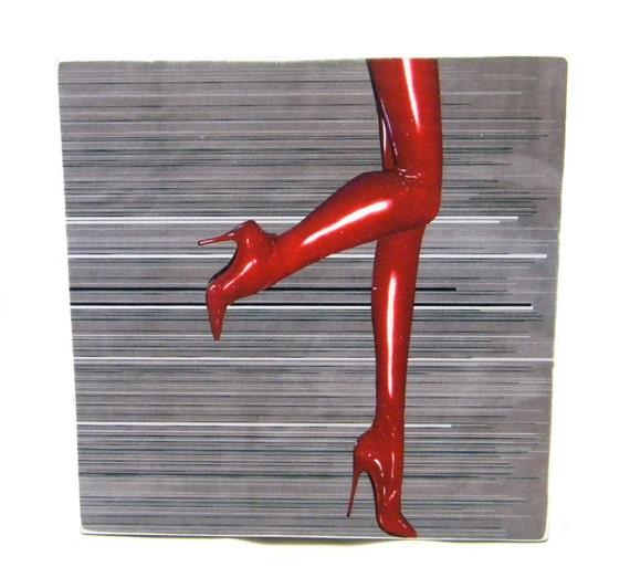 All legs, on wood panel