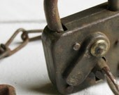 Weathered Vintage French Army padlock on a chain with Two Keys