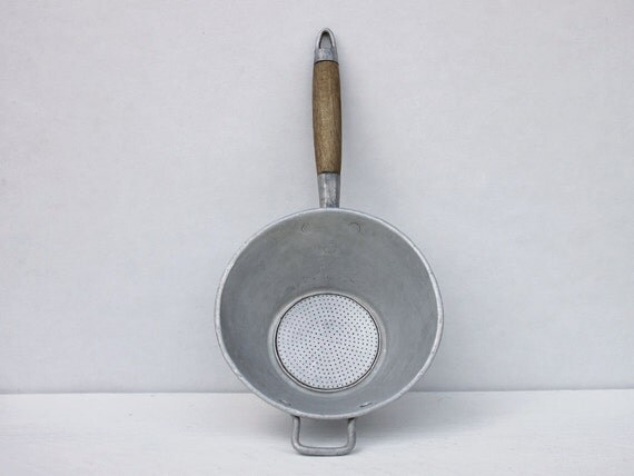Vintage French strainer: A metal strainer with wooden handle