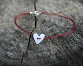 Red silk thread bracelet with brushed Sterling Silver heart