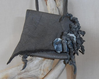 Osmosis--- This Wisdom Pouch is made out of Gray Leather and features a Shell fragment on the flap along with some knotted fringe