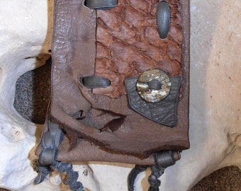 Marine Otter- This Wisdom Pouch is made out of Taupe colored leather and features Fish Hide Leather and an Abalone button on the flap.