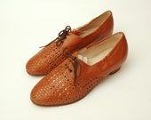 Size 10 Hand Woven Orange brown leather lace up heeled shoes Dead stock vintage