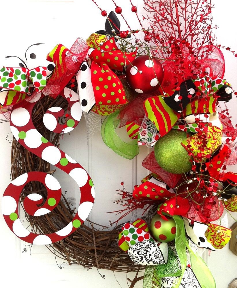 Christmas holiday wreath with metal letter