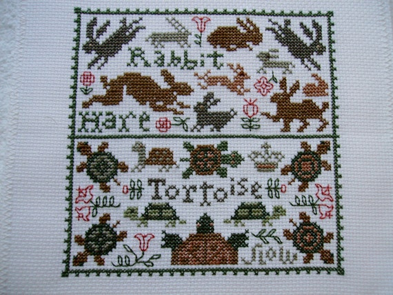 COMPLETED PRAIRIE SCHOOLER CROSS STITCH SAMPLER  -  TORTOISE AND THE HARE