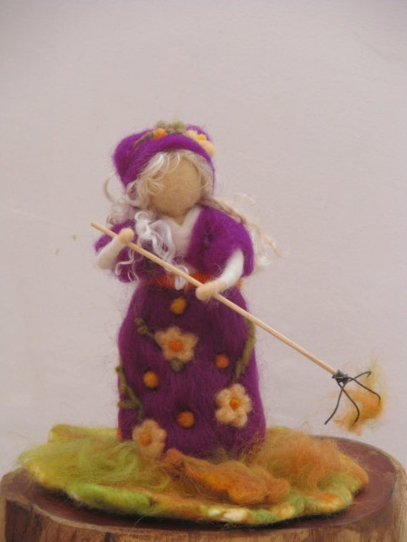 SALE........Needle felted girl collecting fallen leaves