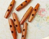 seven (7) wooden toggle buttons 2 inches