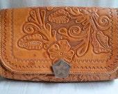 Hand-tooled tan leather purse