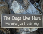 "Listing for a 18"" x 6"" Engraved Wood Sign - The Dogs Live Here... We are just visiting - Great Gift for any Dog Lover"